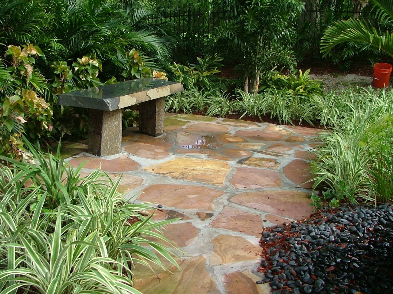 Take a seat on this bench in the outdoor living space designed by Plant Professionals.