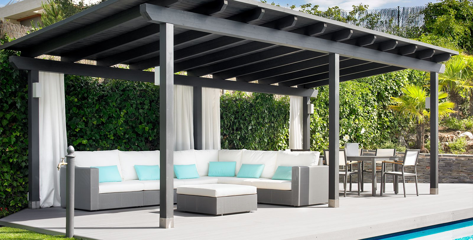 Shade by the pool with a pergola from Plant Professionals. Outdoor living spaces.