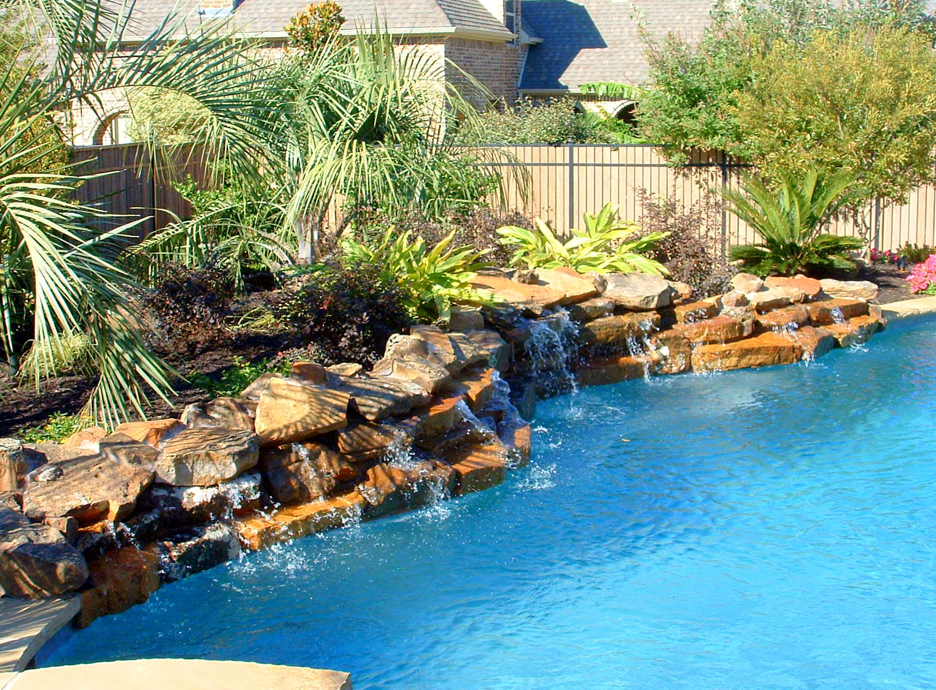 Our Water Feature Design Ideas | Miami | Plant Professionals on Rock Garden Waterfall Ideas id=60781