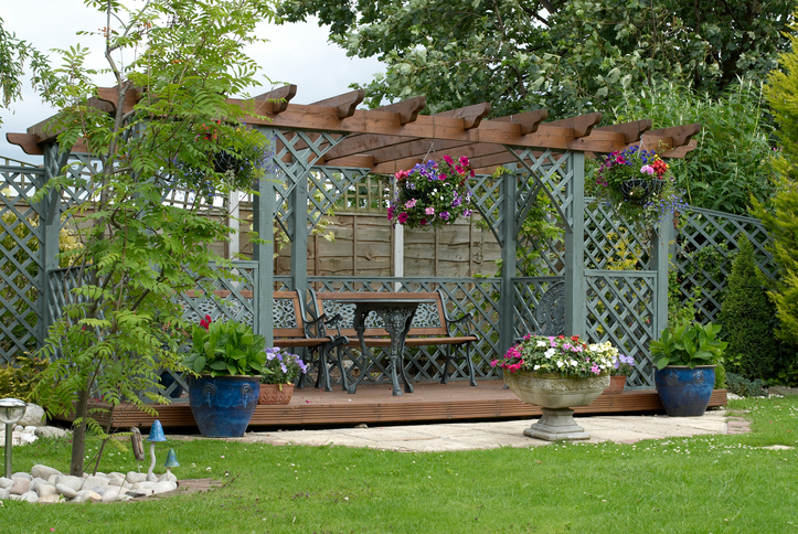 A custom outdoor living space for a small backyard from Plant Professionals.